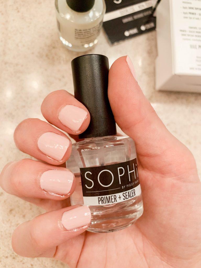 Photo of a hand holding SOPHi Primer + Sealer